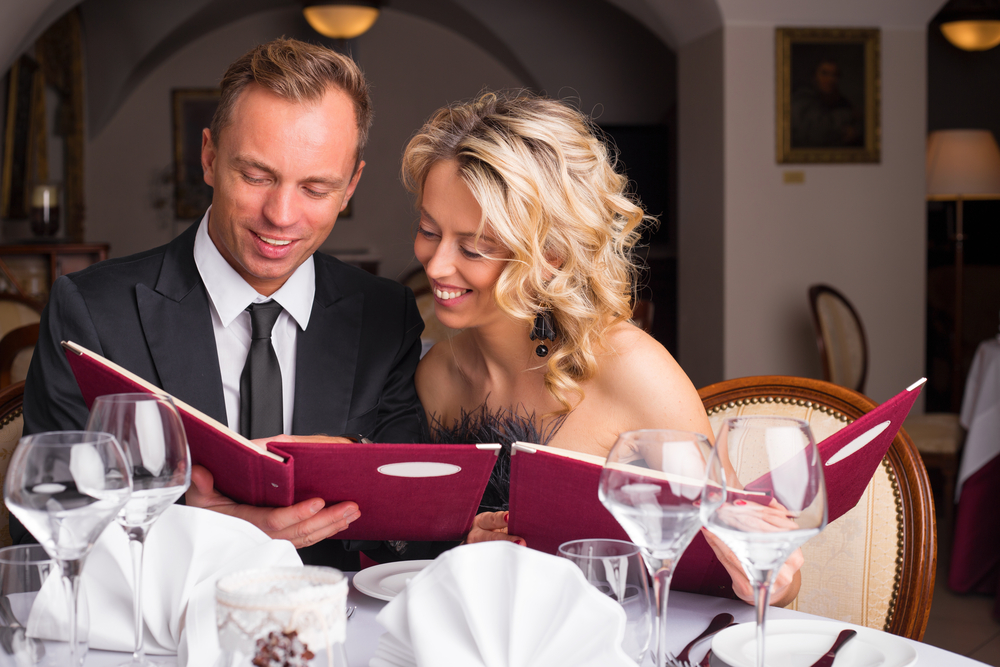 Woman leaning over to look at her dates menu