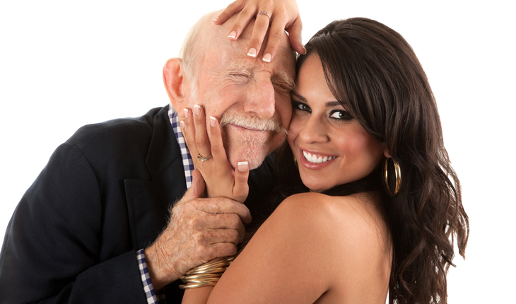 Elder Man with Younger Woman Smiling