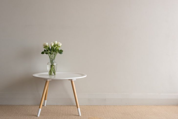 small table against wall