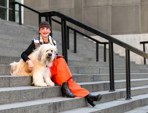 Woman with dog sitting on stairs