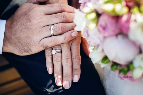 wedding rings on mature hands