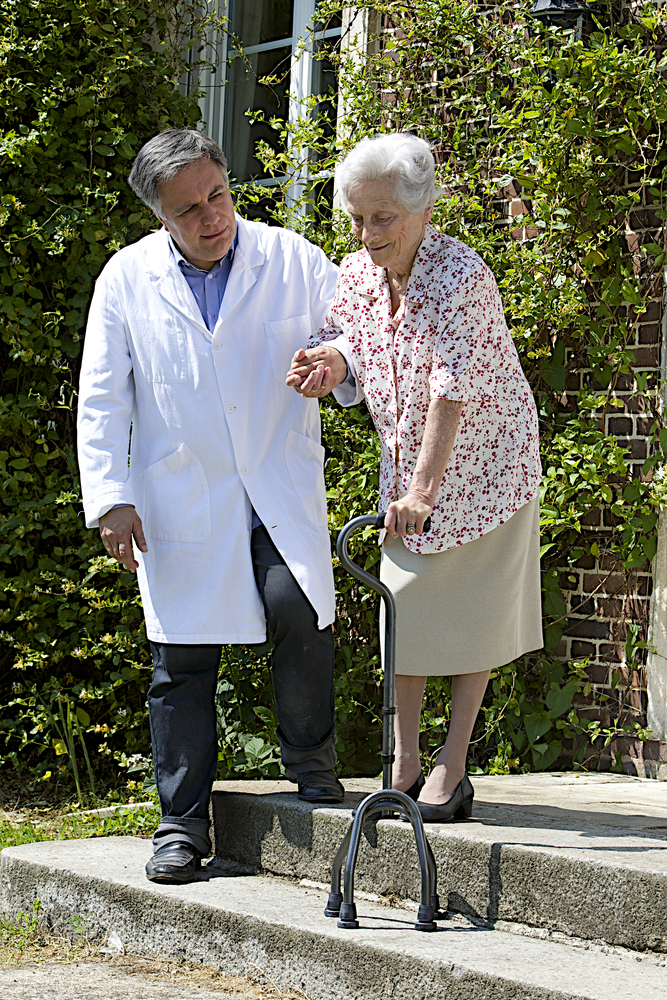 woman with cane and caregiver.jpg