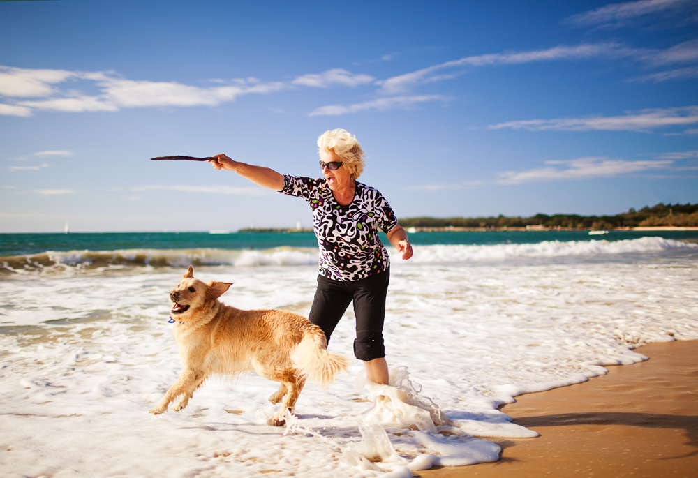 woman with dog on beach.jpg