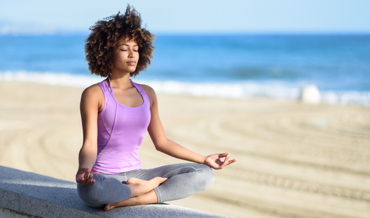 woman-meditating-on-beach