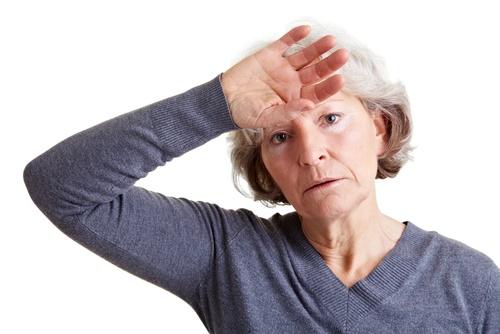 woman sweating hot flash
