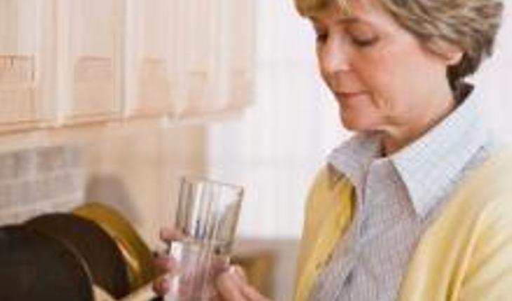 woman-taking-pills.jpg